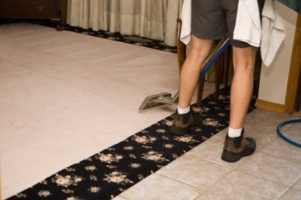 Choice 1 Cleaning LLC technician cleaning carpet via hot water extraction in West Warwick RI.